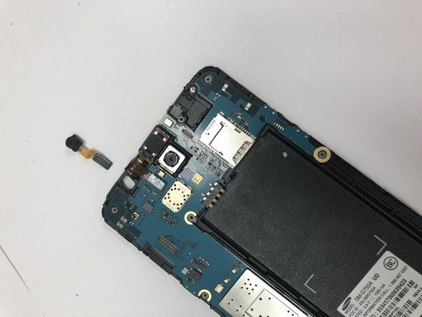 Lift the motherboard connector and remove the camera assembly from phone.