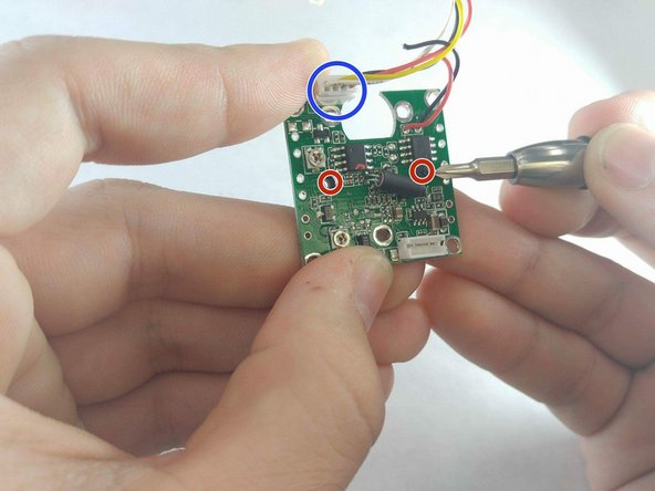 The lens has two 5 mm JIS 0 screws located under the motor's previous location.
