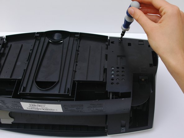 Use a Phillips head #2 screwdriver to remove the 4 screws located on the bottom of the Dell Photo Printer 720.