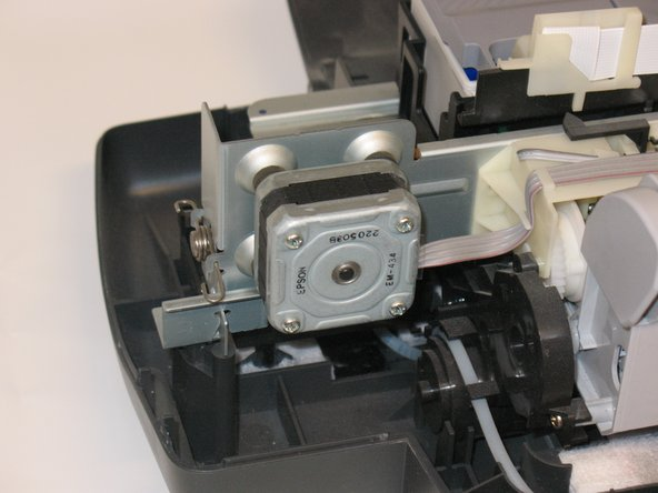 Locate the drive motor.  It is the square object located in the back right of the chassis.