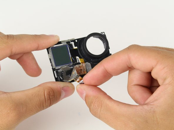 Now that you have removed the plastic midframe from the motherboard, nothing is standing in the way of the LCD!