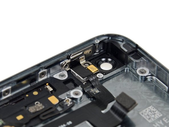 Image 2/2: During reassembly, be sure the bracket is properly seated between the rear-facing camera flash and the top edge of the case.