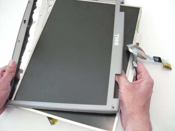 Image 3/3: The LCD display can now be removed from the top cover of the laptop