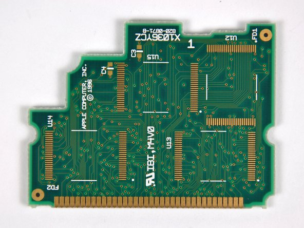 Two LHME5BT3 Sharp mask ROM chips.