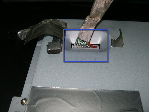Image 3/3: Remove the LVDS cable. It is a simple push connector, just pull the cable upward.