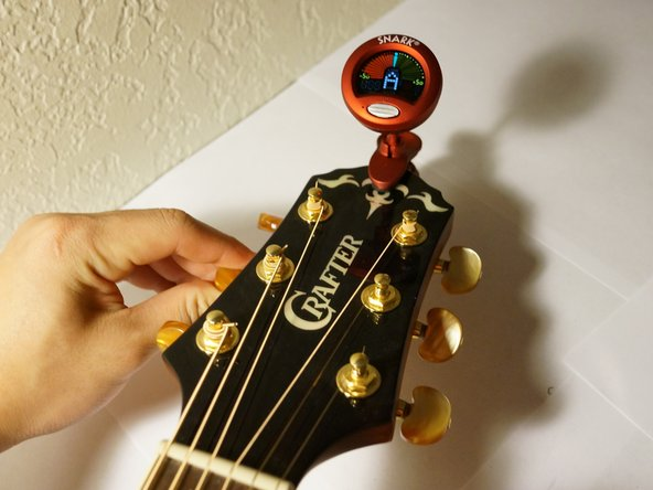 Tune each string by plucking the string and checking the letter musical note indicated on the tuner.