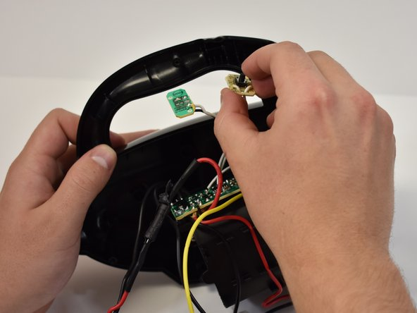 Remove the power button and charge LED light by gently pulling straight out of the case.