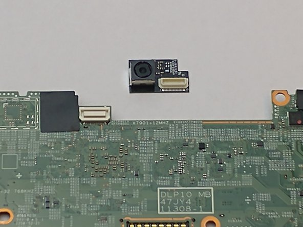 Once the motherboard is removed, place on a flat surface facing down. Use the plastic opening tool to disconnect and remove the camera from the motherboard.