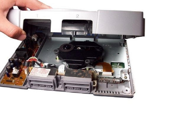 Turn the PlayStation upright. Remove the cover by lifting it up.