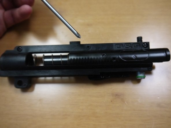 Image 1/2: Remove the five screws on the bolt assembly.