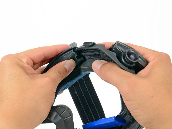 Image 1/3: While firmly holding the keypad cover, pull the top of the strap mount cover up and off of the frame