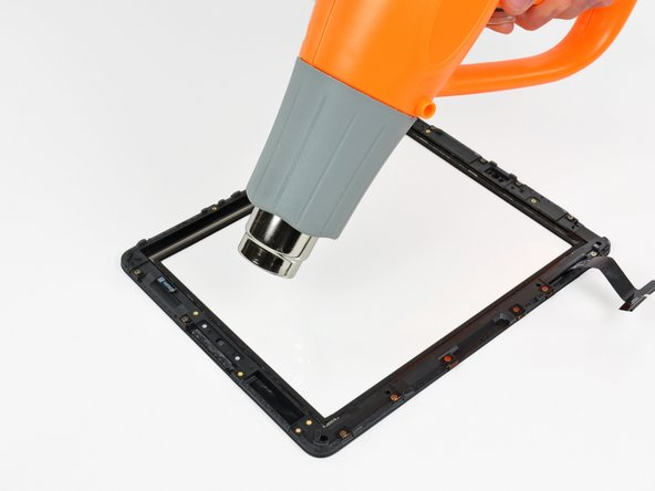 In the following steps you will use a heat gun to soften the adhesive securing the black plastic frame to the front glass. Do not allow the stream of hot air to contact the thin rubber strip around the outer perimeter of the front glass as it may melt, permanently deform, and lose texture.