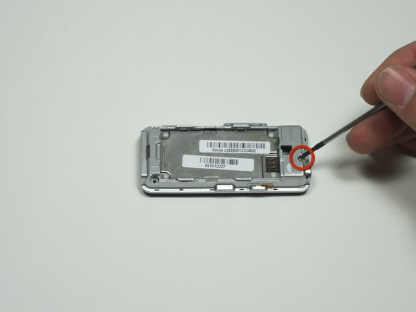 "Remove the single 0.327"" silver screw on the back of the device that was exposed when you removed the rear case cover."
