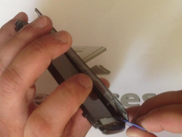 Image 3/3: Gently release the menu flex cable from the touch screen.