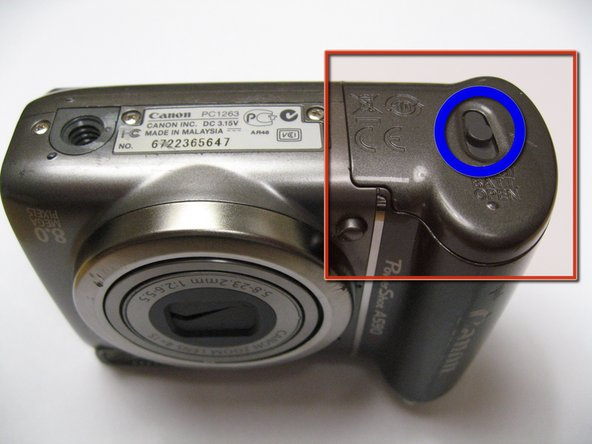The battery hatch is on the bottom of the camera.