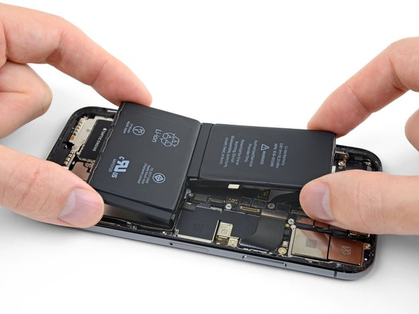 """When installing the battery, be careful not to touch the Face ID camera and sensor hardware along the top edge of the iPhone (the """"notch"""" area)."""