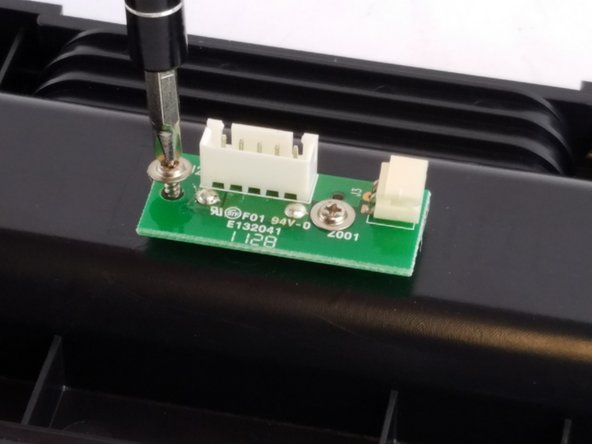 Image 2/3: Remove the charging node from the speaker and set aside.