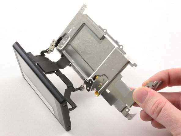 Tilt the LCD away from the metal frame.