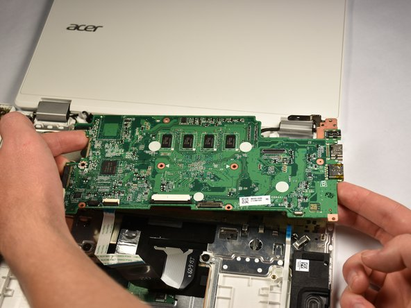 Lift the motherboard upward to completely remove it from the base.