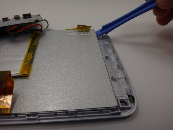 Image 1/2: Leave the plastic opening tool underneath the metal backing to prop it up.