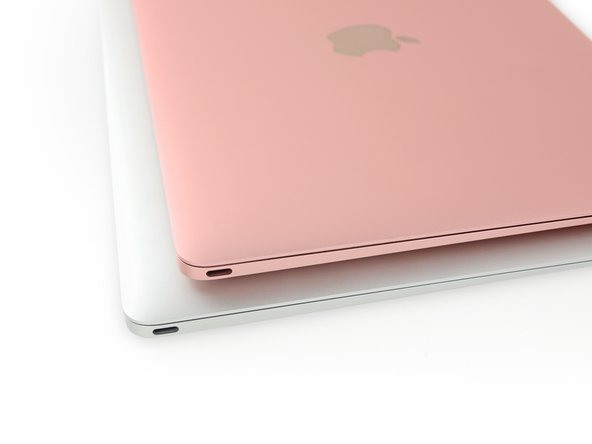 If it weren't for the rose gold finish, we'd be hard-pressed to distinguish between this year's Retina MacBook, and the one of yesteryear.