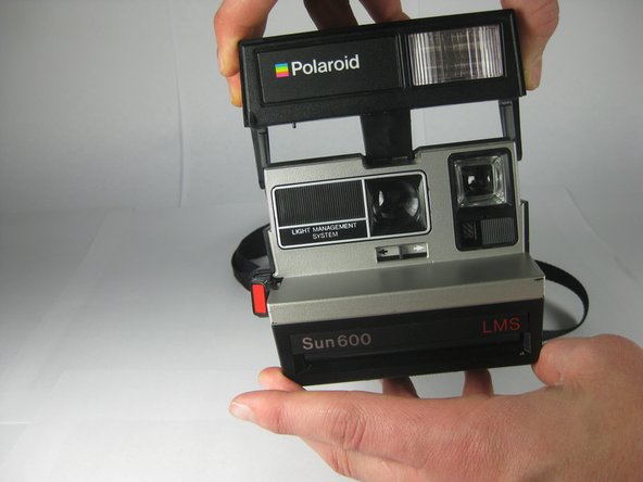 If your camera is old or dirty, it may take more force to open the flash assembly.