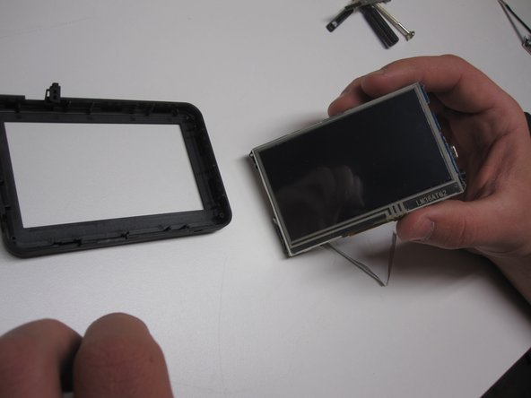 There are four screws one in each corner. Remove them and gently pull out the LCD Screen keep in mind for the buttons.