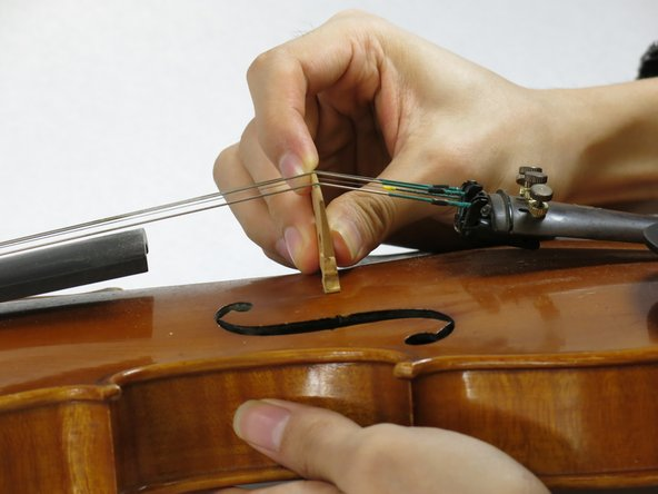 Finally, make any last adjustments to the bridge. Ensure that it is nearly perpendicular to the violin body. Also make sure that the feet of the bridge sit flat on the body of your violin.
