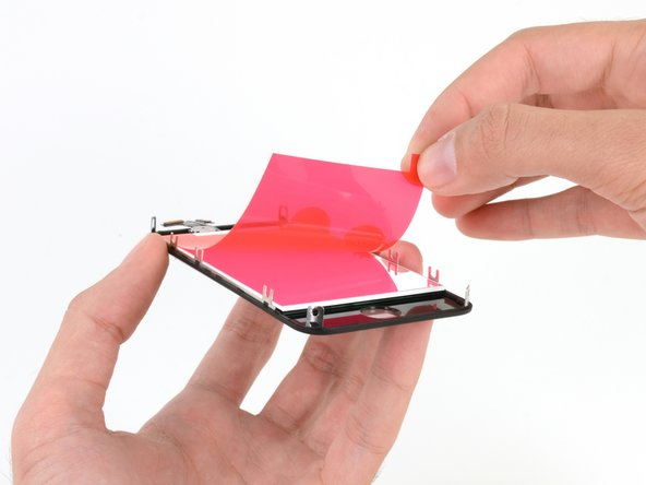 Your replacement display may come with colored plastic film on the back of the LCD. If so, use the pull tab near the home button to peel the plastic film from the LCD before installing the new display in your iPhone.