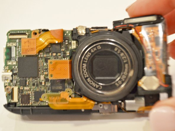 Using your fingers, remove the flash assembly.