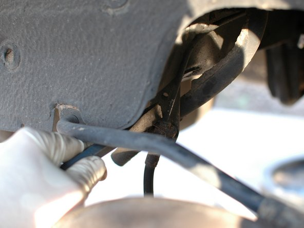 Dirt and grime will also often collect around the smaller upper nut, that of the hard brake line, making it difficult to place a wrench over it.