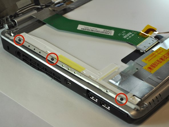 Using a Phillips #00 screwdriver, remove the three 3mm screws located on both the left and right side of the laptop.