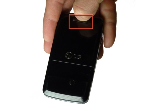 Image 1/2: Place one finger at each side of the battery cover.