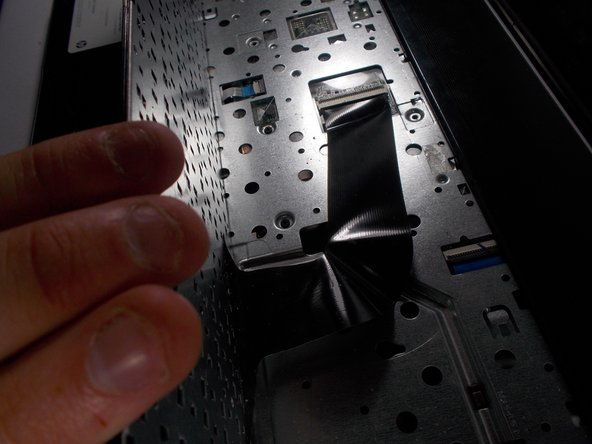 If you meet alot of resistance, go back and make sure you have undone every screw marked with a keyboard symbol.