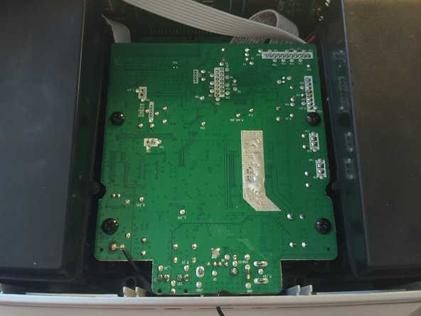 Image 1/2: Gently lift the front side of the board towards you