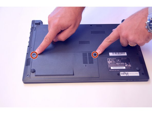 Using the Philips # 0 screwdriver, unscrew the 2 screws from the bottom cover.