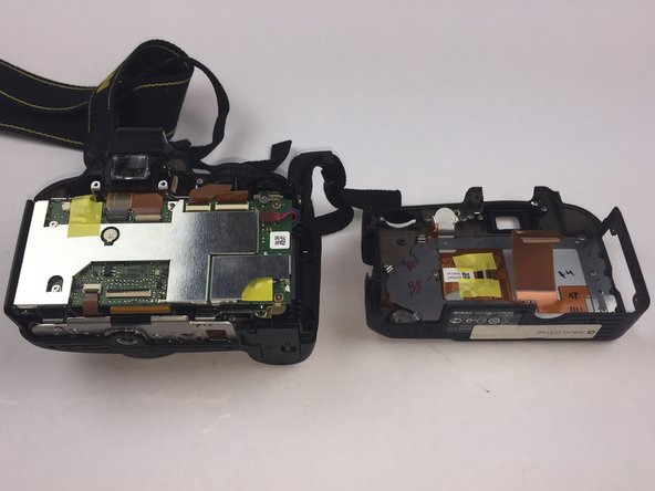 Image 2/2: Carefully remove the ribbon using a spudger to lift up connector and tweezers to pull out ribbon.