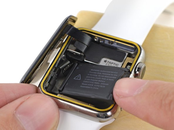 Press the battery down against the S1 to re-adhere it in place.