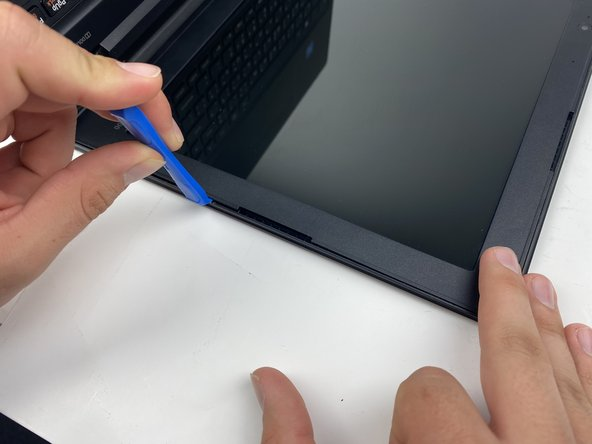 Carefully remove the plastic bezel from the computer screen using a plastic spudger.