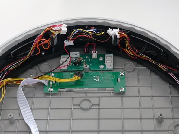 Image 3/3: If there is any glue holding down the other wires, you may scrape it off using a tool such as a screwdriver.