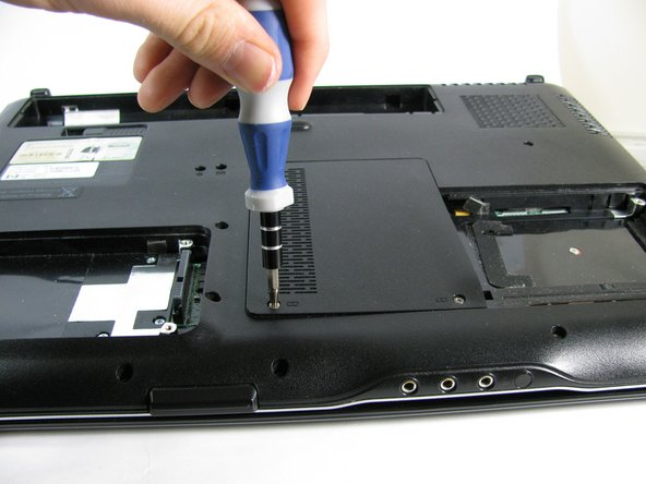 Using a Phillips #1 screwdriver, remove the two 5mm screws on the forward end of the cover.