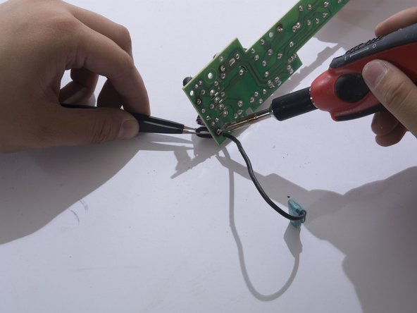 Heat the wire connection's solder joint until the joint looks wet and  liquidy.