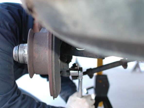 Switch your 19mm socket to a large 1/2 inch drive torque wrench. Torque both of the caliper bolts down to 115 nm/85 lb-ft.