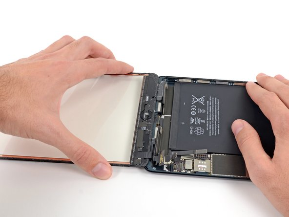 Image 1/2: Lift and remove the front panel from the iPad.