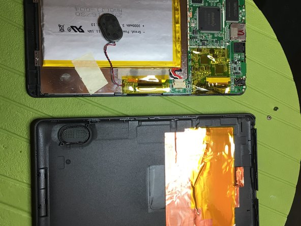 Unscrew the screws and remove the speaker from the back cover.