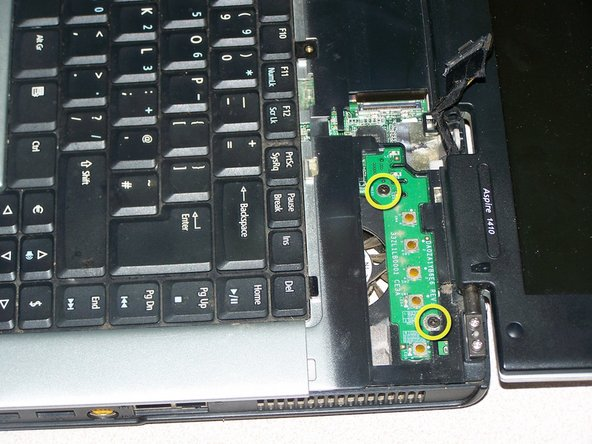 Remove 2 screws securing power board to logicboard.