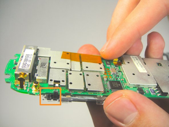 Use your fingers to unhook the highlighted plastic frame of the screen from motherboard