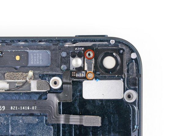 Remove the following screws from the metal bracket between the rear facing flash and camera windows: