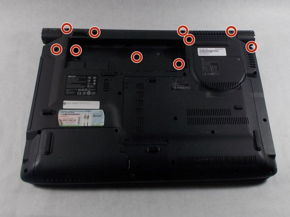 Using the Phillips #1 screwdriver, remove the nine 7mm screws holding the top panel.