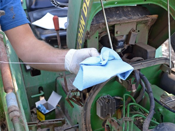 Remove the dipstick, wipe it off with a clean rag or towel, reinsert it, and remove it again.
